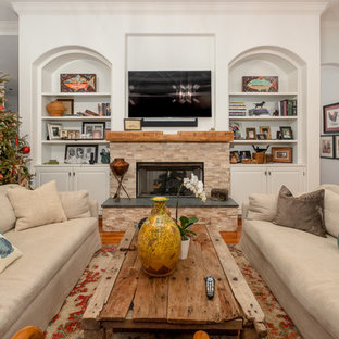 Large eclectic formal open concept living room in Tampa with grey walls, medium hardwood floors, a standard fireplace, a stone fireplace surround, no tv and brown floor.