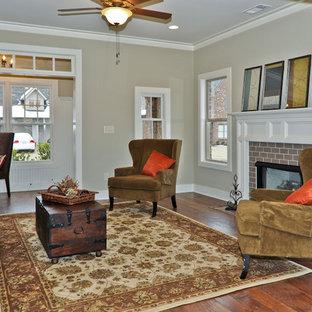 Diseño de salón abierto, clásico, de tamaño medio, sin televisor, con paredes beige, chimenea tradicional, suelo de madera en tonos medios y marco de chimenea de yeso