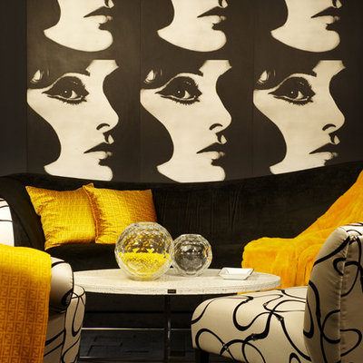 Inspiration for an eclectic living room remodel in Los Angeles with black walls