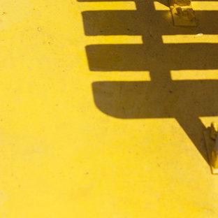ニューヨークの中サイズのインダストリアルスタイルのおしゃれなLDK (ライブラリー) の写真