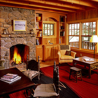 Inspiration for a large rustic open plan living room in Boston with brown walls, light hardwood flooring, a standard fireplace, a stone fireplace surround and no tv.