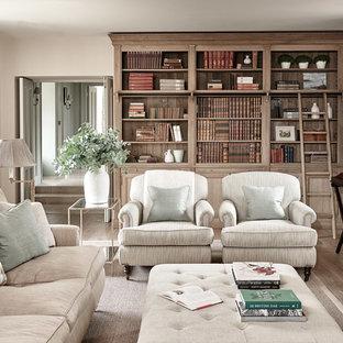 Idéer för lantliga separata vardagsrum, med ett bibliotek, beige väggar, ljust trägolv och en standard öppen spis