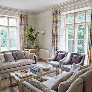 Photo of a traditional formal living room in Gloucestershire with grey walls, medium hardwood flooring and brown floors.