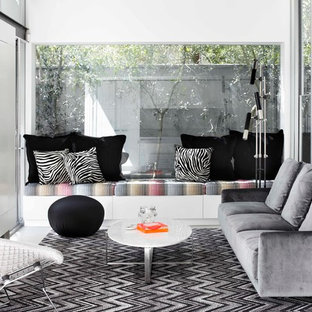 Living room - small contemporary living room idea in Melbourne with white walls and a standard fireplace