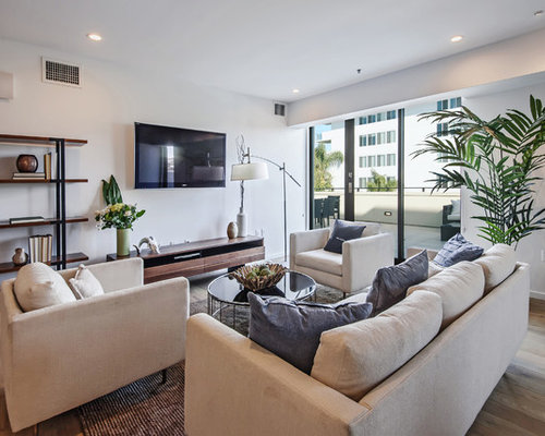 Example Of A Large Trendy Open Concept Living Room Design In Los Angeles  With White Walls