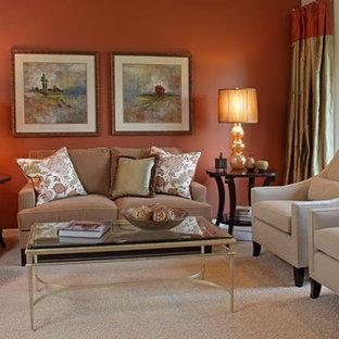 Immagine di un soggiorno chic di medie dimensioni e aperto con sala formale e pareti arancioni