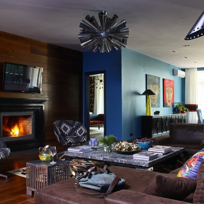 Inspiration for an eclectic living room remodel in Moscow with a standard fireplace