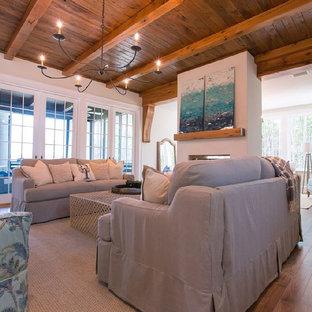 マイアミの巨大なビーチスタイルのおしゃれなLDK (フォーマル、グレーの壁、無垢フローリング、両方向型暖炉、コンクリートの暖炉まわり、テレビなし) の写真