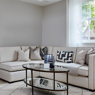 Inspiration for a classic living room in London with grey walls, light hardwood flooring and no fireplace.