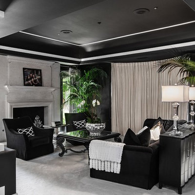 Living room - contemporary living room idea in Orange County with black walls and a standard fireplace