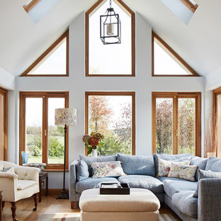Design Ideas For A Classic Living Room In Other With White Walls And Light  Hardwood Flooring