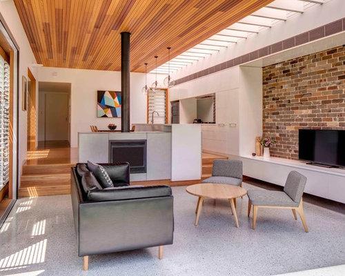 wohnzimmer mit kaminofen und betonboden ideen design
