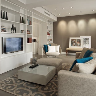 This is an example of a medium sized eclectic living room in Other with a reading nook, brown walls, concrete flooring and a wall mounted tv.