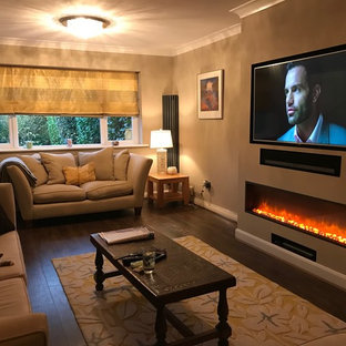 This is an example of a mid-sized contemporary living room in Essex with brown walls and a built-in media wall.