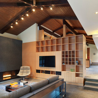 Inspiration for a medium sized contemporary enclosed living room in DC Metro with white walls, slate flooring and a standard fireplace.