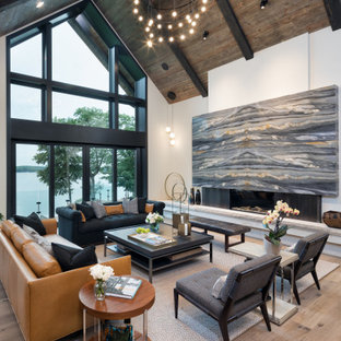 Living room - large contemporary formal and open concept light wood floor and brown floor living room idea in Minneapolis with white walls, a ribbon fireplace, no tv and a wood fireplace surround