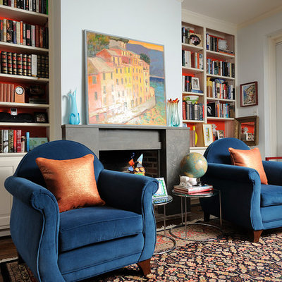Eclectic dark wood floor living room library photo in Philadelphia with blue walls and a standard fireplace