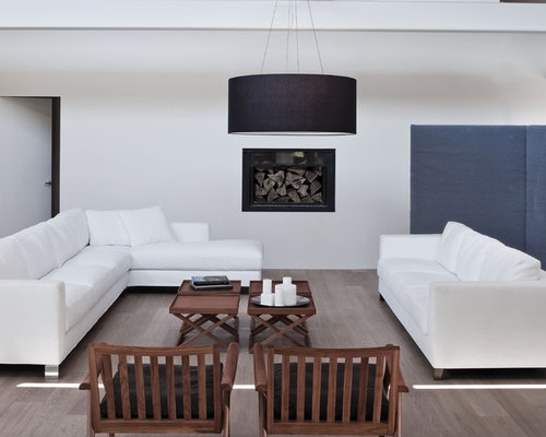example of a minimalist living room design in with white walls