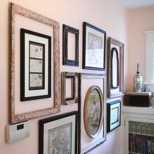 ポートランドの中くらいのシャビーシック調のおしゃれな独立型リビング (フォーマル、ピンクの壁、淡色無垢フローリング、標準型暖炉、タイルの暖炉まわり、テレビなし) の写真