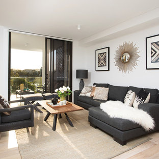 Design ideas for a contemporary living room in Brisbane with white walls and light hardwood floors.