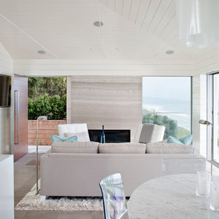 Example of a mid-sized coastal open concept living room design in San Diego with white walls and a wall-mounted tv