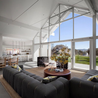 Inspiration for a cottage open concept concrete floor living room remodel in San Francisco with white walls