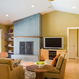 Mid-century modern living room photo in San Francisco with yellow walls, a standard fireplace and a tv stand