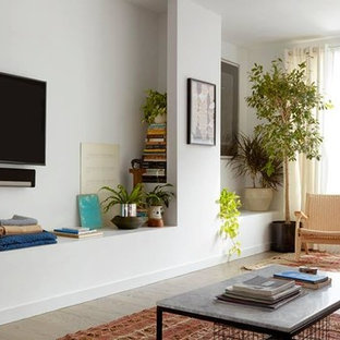 Example of a mid-sized trendy light wood floor and gray floor living room design in Los Angeles with white walls, no fireplace and a wall-mounted tv