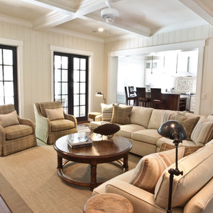 Inspiration for a huge coastal living room remodel in Charleston with white walls