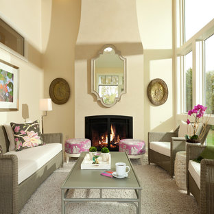 This is an example of a traditional formal living room in Minneapolis with beige walls, a standard fireplace and carpet.