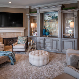 Inspiration for a large transitional open concept travertine floor and beige floor living room remodel in Houston with brown walls, a standard fireplace, a stone fireplace and a wall-mounted tv