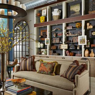 ミネアポリスの中サイズのエクレクティックスタイルのおしゃれなリビングロフト (マルチカラーの壁、トラバーチンの床、標準型暖炉、タイルの暖炉まわり) の写真