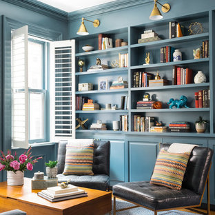 Inspiration for a transitional living room library remodel in Boston with blue walls