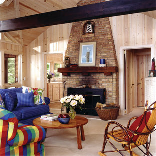 Inspiration for a mid-sized rustic formal and open concept carpeted and beige floor living room remodel in Grand Rapids with beige walls, a standard fireplace, a brick fireplace and no tv