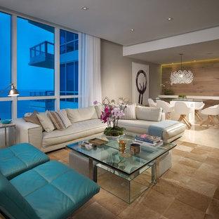 Immagine di un soggiorno minimal di medie dimensioni e aperto con pareti grigie, pavimento in marmo, nessun camino e parete attrezzata