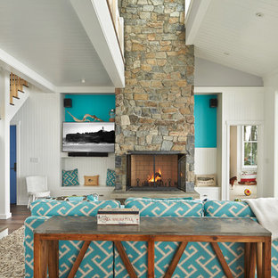 Inspiration for a beach style formal and open concept living room remodel in Seattle with blue walls, a standard fireplace and a wall-mounted tv