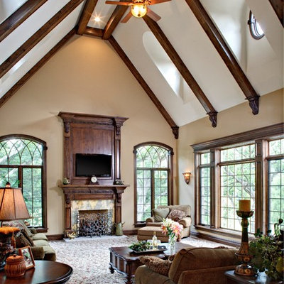 Example of a large classic open concept carpeted and multicolored floor living room design in Chicago with beige walls, a standard fireplace, a tile fireplace and a wall-mounted tv