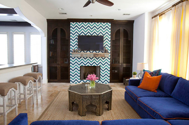 Mediterranean Living Room by Laura U, Inc.