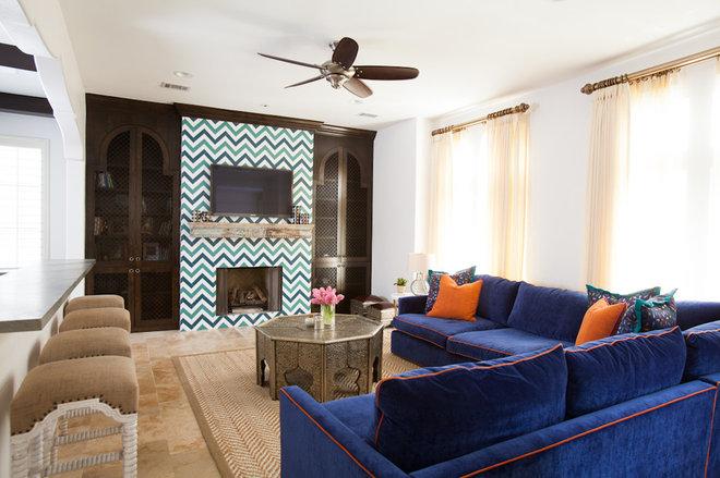 Mediterranean Living Room by Laura U, Inc.