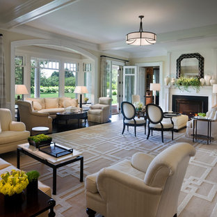 Example of a huge ornate living room design in New York with beige walls and a standard fireplace