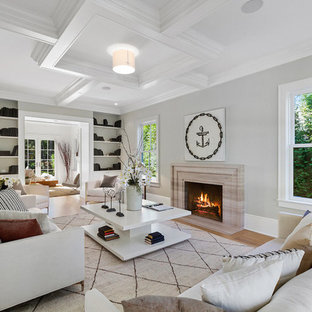 Example of a coastal formal and enclosed light wood floor living room design in Los Angeles with gray walls, a standard fireplace, a stone fireplace and no tv