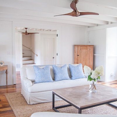 Large beach style formal and open concept medium tone wood floor living room photo in Other with white walls, no tv, a standard fireplace and a brick fireplace