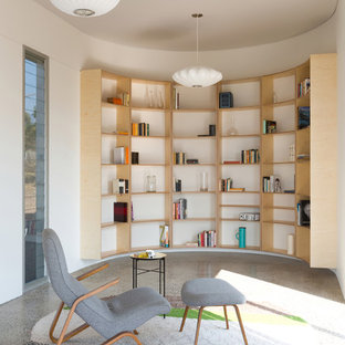 Design ideas for a mid-sized contemporary open concept living room in Sydney with a library and white walls.