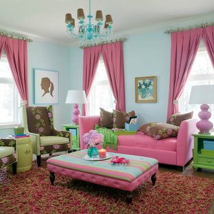 Photo of a medium sized traditional enclosed living room in Little Rock with blue walls and medium hardwood flooring.