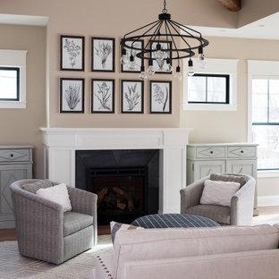 インディアナポリスの中サイズのトランジショナルスタイルのおしゃれなLDK (フォーマル、ベージュの壁、無垢フローリング、標準型暖炉、コンクリートの暖炉まわり、テレビなし、茶色い床) の写真