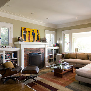 Minimalist enclosed living room photo in Portland with a standard fireplace, a brick fireplace and no tv