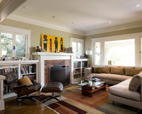 Minimalist Enclosed Living Room Photo In Portland With A Standard Fireplace And Brick Surround