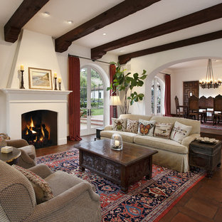 Inspiration for a mid-sized timeless formal and open concept terra-cotta floor living room remodel in Santa Barbara with white walls, a standard fireplace, a plaster fireplace and no tv