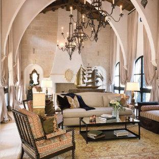 Ispirazione per un grande soggiorno mediterraneo chiuso con sala formale, pavimento in pietra calcarea, camino classico, cornice del camino in intonaco e nessuna TV
