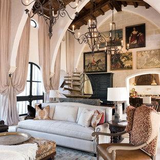 ジャクソンビルの大きい地中海スタイルのおしゃれな独立型リビング (フォーマル、ライムストーンの床、テレビなし、白い壁) の写真